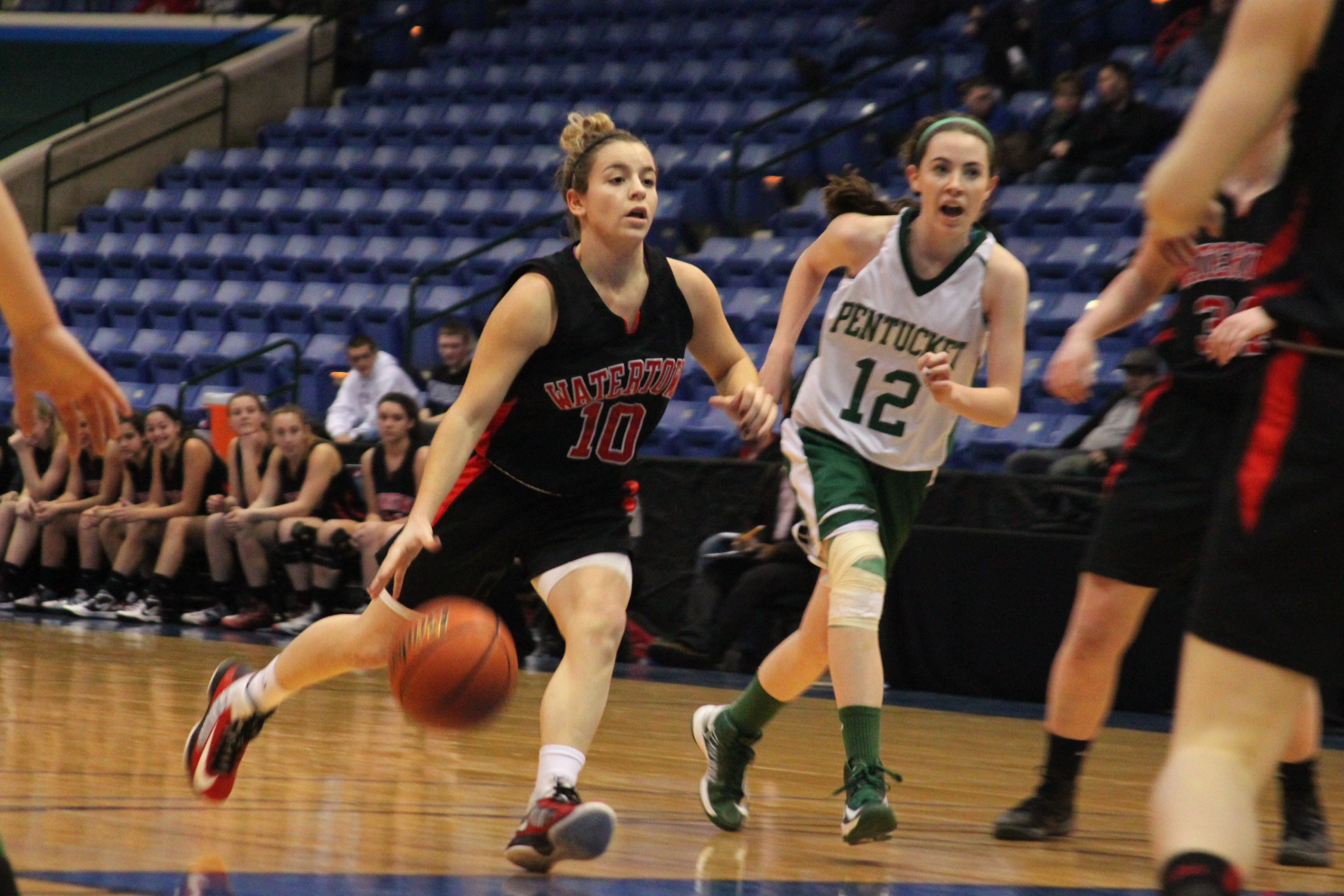 Watertown's girl's basketball team and Gabriella Coppola return to the North Section final for the second straight year. Here Coppola brings the ball up in the 2013 North Section Final against Pentucket. Photo by Charlie Breitrose
