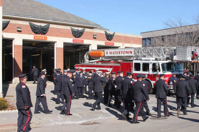 Firefighters from around the state and across the U.S. came to Tuesday's wake. Here they gather outside Watertown Fire Headquarters. Photo by Charlie Breitrose.