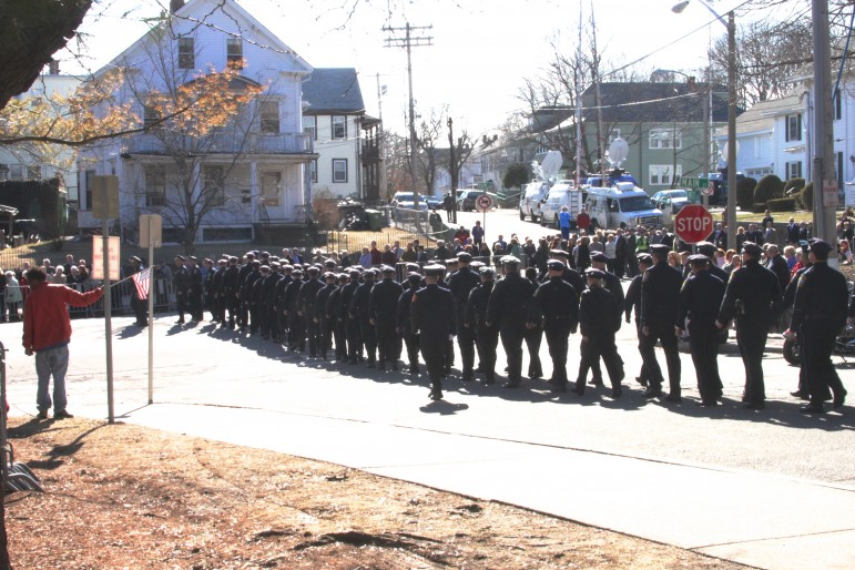 Firefighters march toward the wake for Boston Fire Lt. Edward Walsh. Photo by Charlie Breitrose