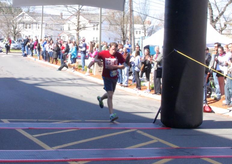 Winner of the Finish Strong 5K John Lequin of Salem.