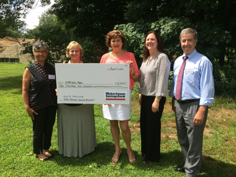 Watertown Savings Bank officials present a check to the Greater Waltham Arc. From left, WSB Vice President and Marketing Officer Carole Katz; WSB Assistant Vice President and Waltham resident Rose Herron; GWarc Executive Director Roz Rubin; WSB Community Relations Manager Kelly Cronin; and WSB Assistant Vice President, Facilities Manager Brian Murphey.