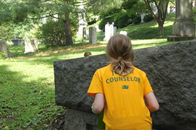 A camper from the Vacation Garden School spotted a chipmunk on one of the grave stones at Mount Auburn Cemetery.