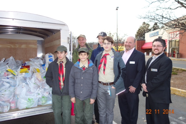 Boy Scouts outside of Stop & Shop, Watertown St. - Nicholas Cordiero, Levi Mattison, Gavin Like, Miles Hohmann, Stop & Shop Store Manager Richard Nolan, Stop & Shop Assistant Store Manager Devin Haywood; back row: Scoutmaster Christopher DeRocher and Gavin Like.