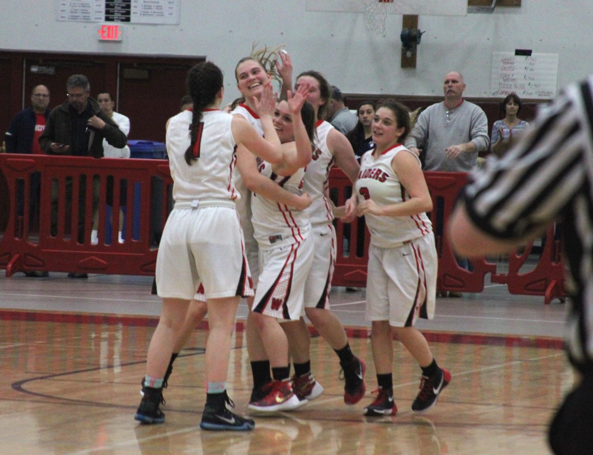 The Watertown girls basketball team celebrates defeating Triton in the Div. 2 North Section semifinal.