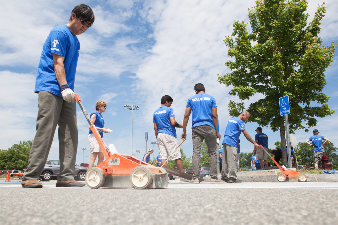 Another project during the Tufts Health Plan volunteer day was building ramps and and striping the lot at Community Rowing in Brighton.